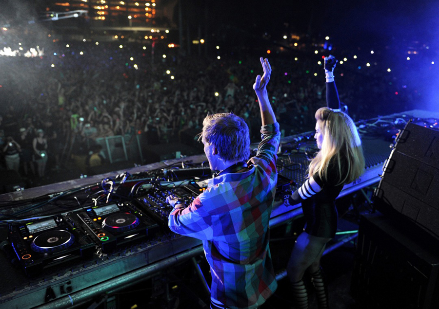 Mainstage Madge: Madonna flanks Avicii at Ultra. By Seth Browarnik/worldredeye.com