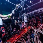 Steve Aoki showers an excited crowd with champagne.