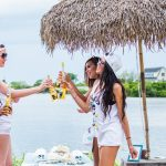 The Chromeo girls share a Corona.