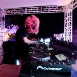 OWSLA fav Mija headbangs it out behind the decks. | Photo by Gustavo Caballero/Getty Images for SiriusXM